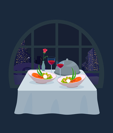 A tablecloth table in a restaurant with food and wine. Evening meal.