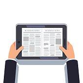 Tablet computer or eReader in businessman hands