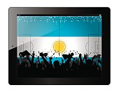 Tablet with soccer filed and fans cheering over Argentina flag.