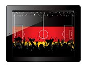Tablet with soccer filed and fans cheering over Germany flag.