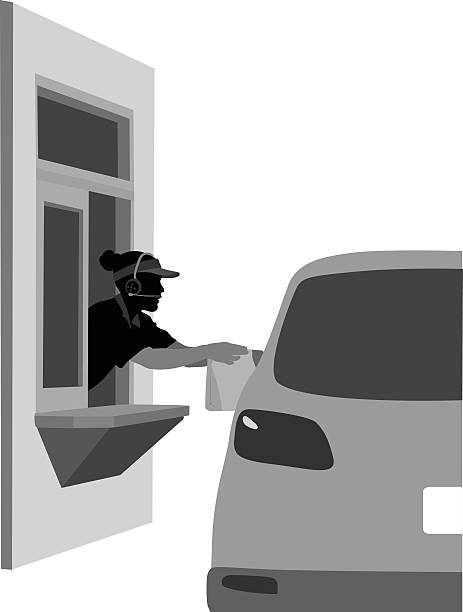 Take Out Worker A vector silhouette illustration of a woman working in a drive-thru handing out food to people in their car through the take out window. minimum wage stock illustrations