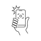 Taking selfie on smartphone concept creative icon selfie label. Hand holding smartphone linear icon. Thin line illustration. Smart phone photocamera. Editable Stroke