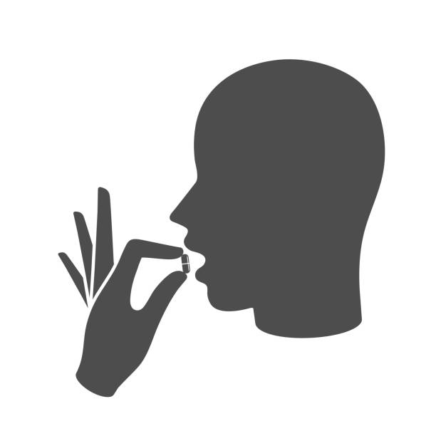 Taking the medicine icon concept Head with open mouth and a hand holding a medicine pill using mouth stock illustrations