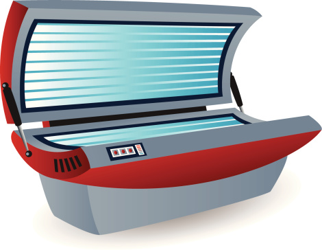 A LED tanning bed in red and silver