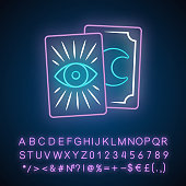Tarot cards neon light icon. Tarocchi, tarock, oracle playing cards. Fortune telling, divination, cartomancy. Magic and superstition. Glowing sign with alphabet, numbers. Vector isolated illustration