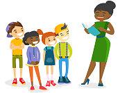 Teacher reading a book to multiethnic children