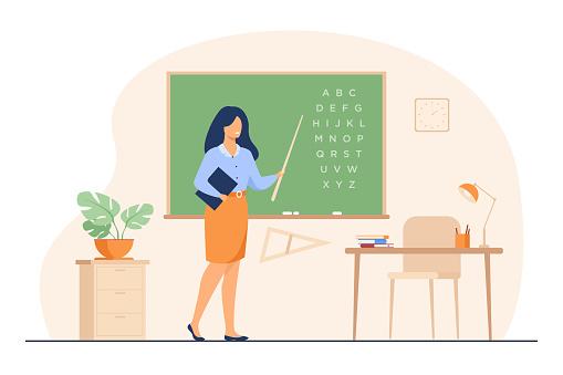 Teacher standing near blackboard and holding stick
