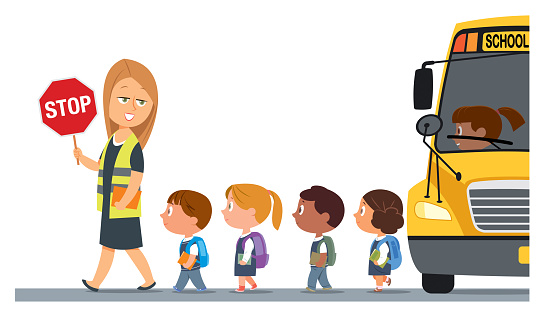 Teacher with a safety vest and stop sign walking with schoolchildren