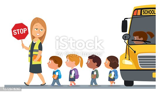 istock Teacher with a safety vest and stop sign walking with schoolchildren 1272978262