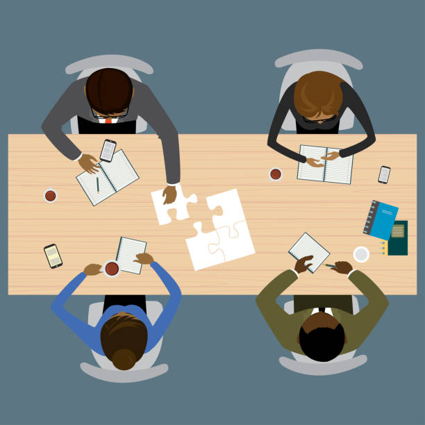 Teamwork, brainstorming, startup. Flat vector illustration Four people different races sitting and working together at the round table. Global Teamwork, brainstorming. Flat vector illustration four people stock illustrations