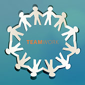 Cutted paper people holding hands in a circle for teamwork concept.