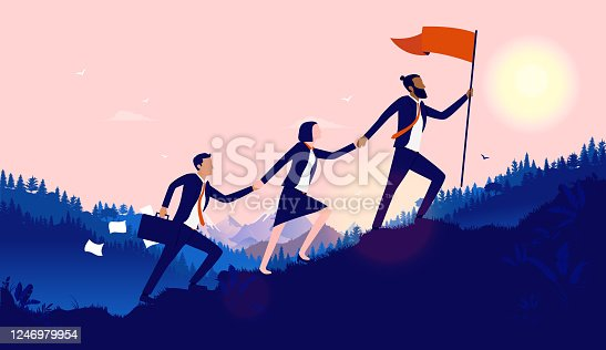 istock Teamwork diversity - A small group of businesspeople walking up hill to plant flag at the top 1246979954