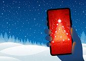 istock Technology Christmas - Circuit board Christmas tree on smartphone 1288105856