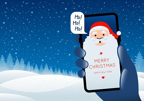 Technology Christmas - Santa Claus on a smartphone