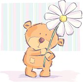 A cool teddy bear and flower.
