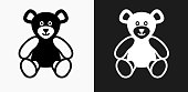 Teddy Bear Icon on Black and White Vector Backgrounds. This vector illustration includes two variations of the icon one in black on a light background on the left and another version in white on a dark background positioned on the right. The vector icon is simple yet elegant and can be used in a variety of ways including website or mobile application icon. This royalty free image is 100% vector based and all design elements can be scaled to any size.