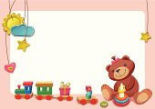 Background with smiley teddy bear, blocks, hanging toys, and gift.
