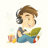 Vector illustration of a music loving teenager using laptop. This fun and charming character is great for personal blog and other social-network related project.