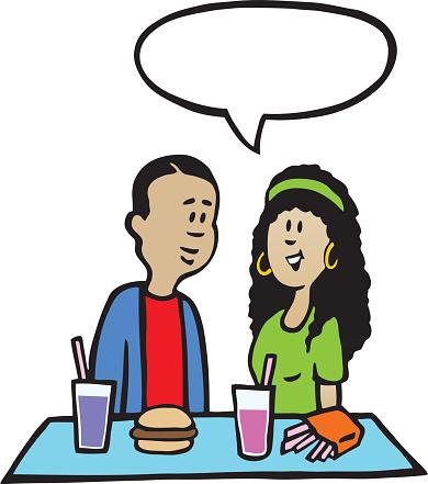 Teen Boy And Girl Having Lunch