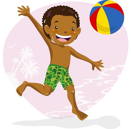 Teenage boy playing beach ball on beach