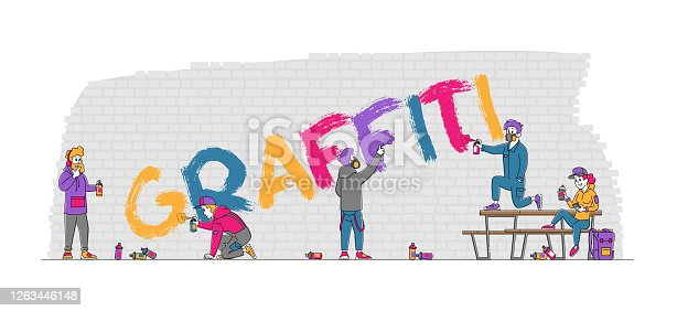 istock Teenager Painting Graffiti on Brick Wall. Urban Teen Lifestyle, Young People Creative Hobby, Men and Women Paint Drawing 1263446148