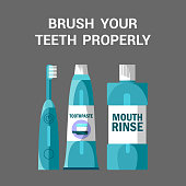 Teeth Brushing Accessories Vector Illustration. Oral Cavity Hygiene Flat Banner with Typography. Toothbrush, Toothpaste Tube and Mouth Rinse Bottle on Grey Background. Dental Health Care Poster