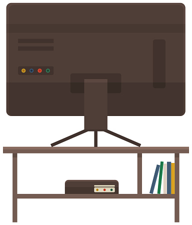 Televisor on table, monitor on shelf with books. TV on stand. Living room interior element