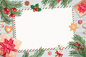 Template of Christmas Letters and wishes on wooden background with traditional decorations-gift box with bow,candy cane,spruce branch and gingerbread.Wish List for kids for the holidays.Vector.