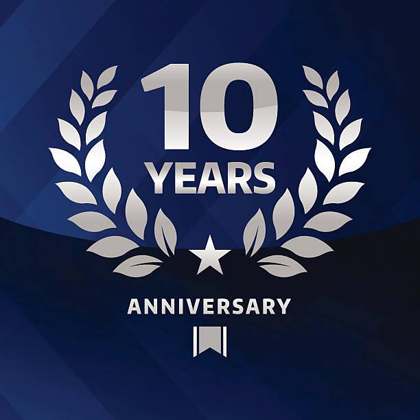 Ten years Anniversary emblem Vector of silver grey anniversary emblem for ten years with blue background. anniversary symbols stock illustrations