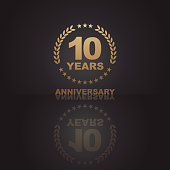Vector of Ten years golden anniversary icon with dark color background. EPS Ai 10 file format.