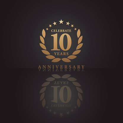 Ten years golden anniversary icon with dark color background