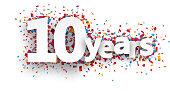 Ten years paper confetti sign