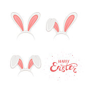 Text Happy Easter and set of rabbit ears on white background
