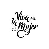 text in Spanish: Cheers for women. Feminism quote, woman motivational slogan. lettering. Vector design. Viva la Mujer