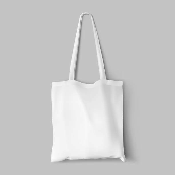 textile tote bag for shopping mockup. - лекало stock illustrations