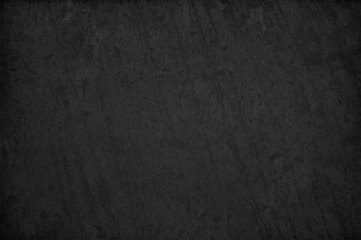 Textured black coloured grunge old vector backgrounds resembling a slate rock or blackboard