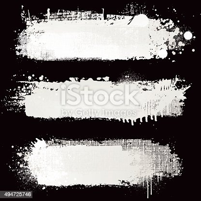 Grunge white paint design textures on a black background.