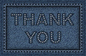 Blue jeans frame with stitches and thank sign.