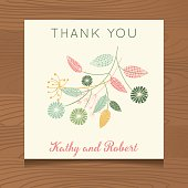 Wedding Thank You Template. Wooden background with thank you note  card. Decorated with floral designs.