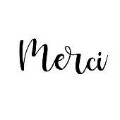 Merci, ink hand lettering. Modern brush calligraphy. Handwritten phrase in French.