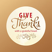 Gold colored greeting card for the Thanksgiving Day with symbol of acorn and leaves