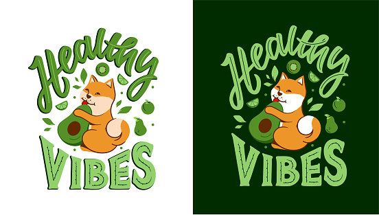 The akita dog with phrase - Healthy vibes. The puppy is eating avocado