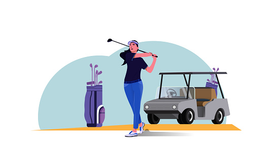 The beautiful female golfer swings the golf ball.  Golf course and golf cart with a  bag of golf clubs