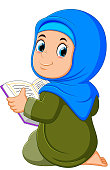 the beautiful girl with blue veil is holding al quran