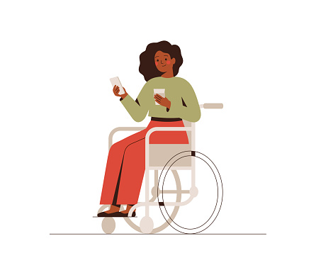 The black businesswoman is sitting in a wheelchair with a mobile phone at the break time. Young dark skin disabled girl drinking coffee and using a smartphone.