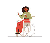 istock The black businesswoman is sitting in a wheelchair with a mobile phone at the break time. Young dark skin disabled girl drinking coffee and using a smartphone. 1267287172