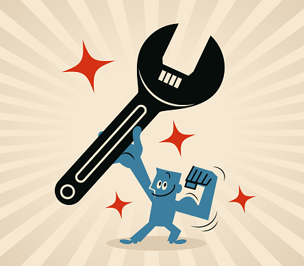 The blue-collar worker is holding a big wrench and showing biceps