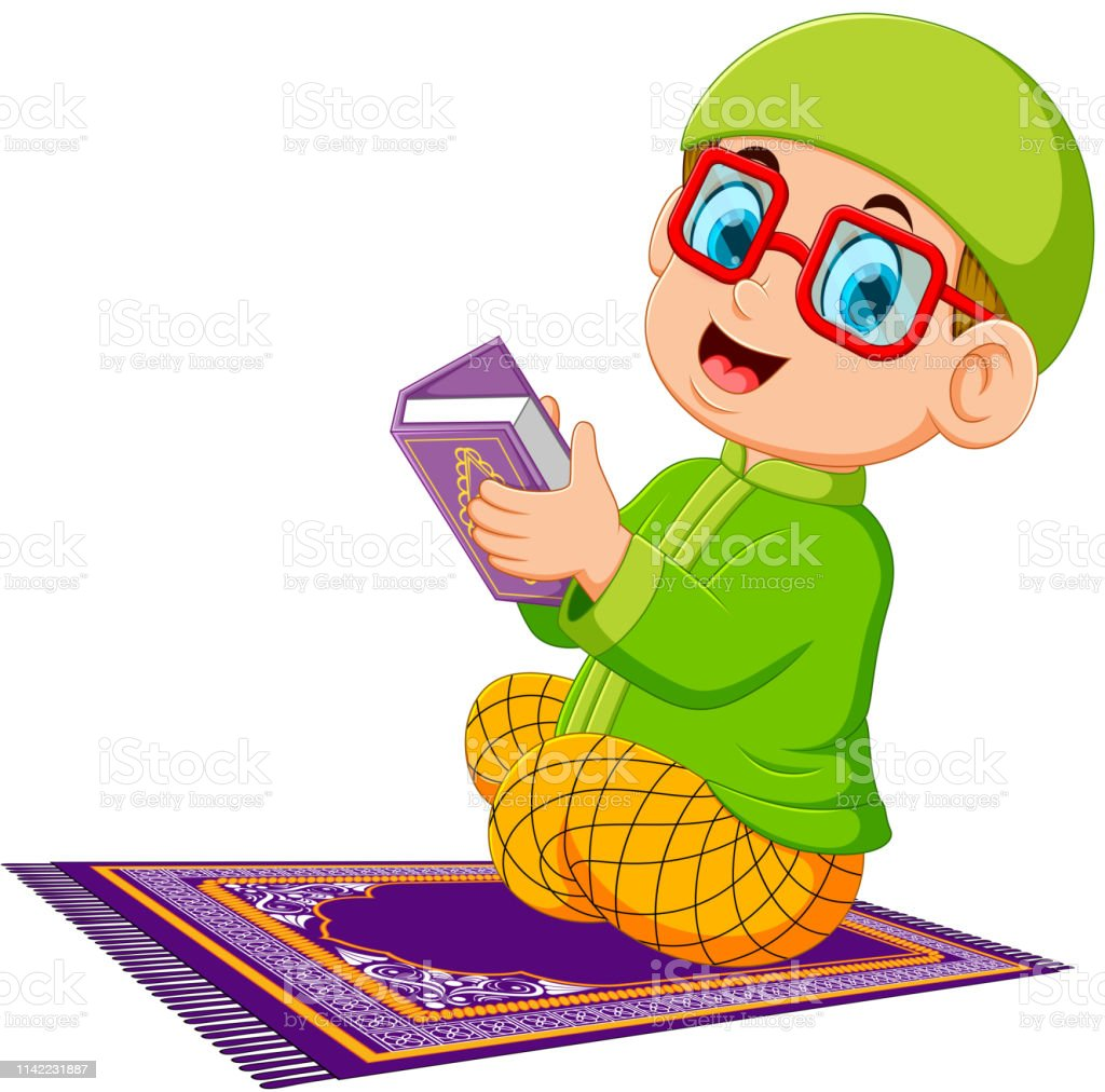 the boy using the red glasses is holding al quran