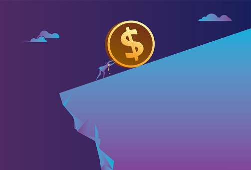 The business man pushes the dollar hard on the cliff
