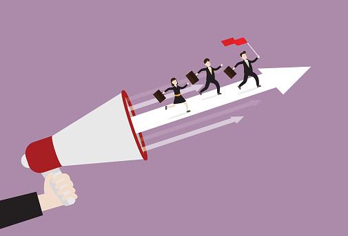 The business team runs on an arrow from a megaphone